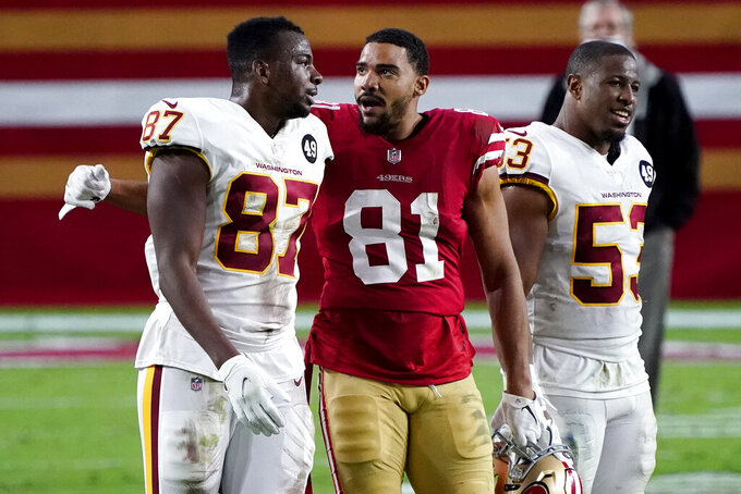 Washington Football Team tight end Jeremy Sprinkle (87) greets San Francisco 49ers tight end Jordan Reed (81) after an NFL football game, Sunday, Dec. 13, 2020, in Glendale, Ariz. Washington won 23-15. (AP Photo/Rick Scuteri)