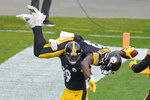 Pittsburgh Steelers wide receiver JuJu Smith-Schuster (19) spins wide receiver James Washington (13) on his shoulders after Washington caught a touchdown pass against the Cleveland Browns during the first half of an NFL football game, Sunday, Oct. 18, 2020, in Pittsburgh. (AP Photo/Gene J. Puskar)
