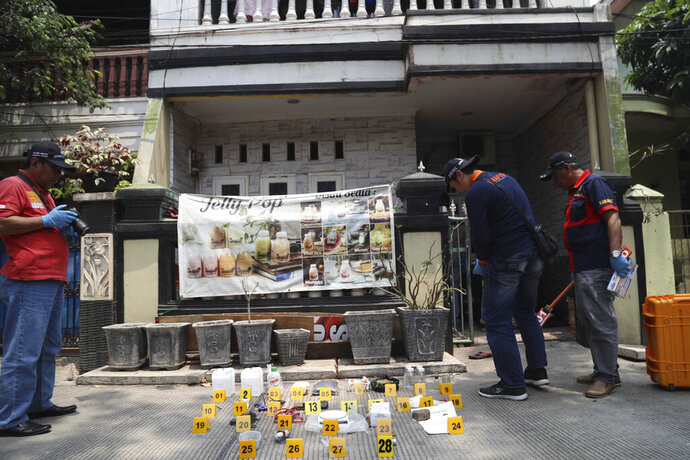 Explosives and bomb-making components that were confiscated by the police during a raid on a safe house of suspected militants are displayed in Jakarta, Indonesia, Monday, Sept. 23, 2019. Police say they have arrested nine suspected militants accused of plotting a suicide bomb attack on police. (AP Photo)