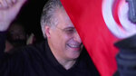 In this image from TV, Tunisian presidential candidate and media mogul Nabil Karoui, is greeted by jubilant crowds after he was released from prison in Mannouba, Tunisia, Wednesday Oct. 9, 2019, just four days before the upcoming presidential runoff election.  Karoui has been jailed since August under investigation for alleged money laundering and tax fraud that he asserts as a politically motivated smear campaign. (AP Photo)