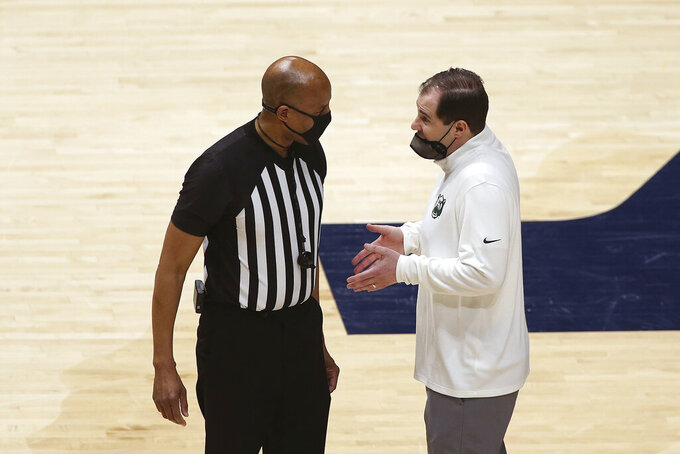 Baylor coach Scott Drew speaks with an official during the second half of the team's NCAA college basketball game against West Virginia on Tuesday, March 2, 2021, in Morgantown, W.Va. (AP Photo/Kathleen Batten)