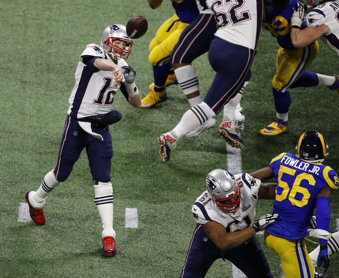 New England Patriots' Tom Brady (12) works against the Los Angeles Rams during the first half of the NFL Super Bowl 53 football game Sunday, Feb. 3, 2019, in Atlanta. (AP Photo/Charlie Riedel)