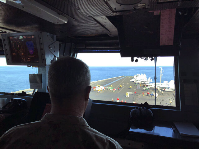 FILE - In this Feb. 1, 2020, file photo Marine Gen. Frank McKenzie, top U.S. commander for the Middle East, watches flight operations on board the USS Harry S. Truman in the North Arabian Sea. Six months after a deadly American airstrike in Baghdad enraged Iraqis and fueled demands to send all U.S. troops home, McKenzie is talking optimistically about keeping a smaller, but enduring military presence in Iraq. (AP Photo/Lolita Baldor, File)