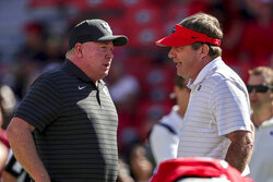 Kentucky head coach Mark Stoops, left, talks with Georgia head coach Kirby Smart before the start of an NCAA college football game Saturday, Oct. 16, 2021 in Athens, Ga. (AP Photo/Butch Dill)