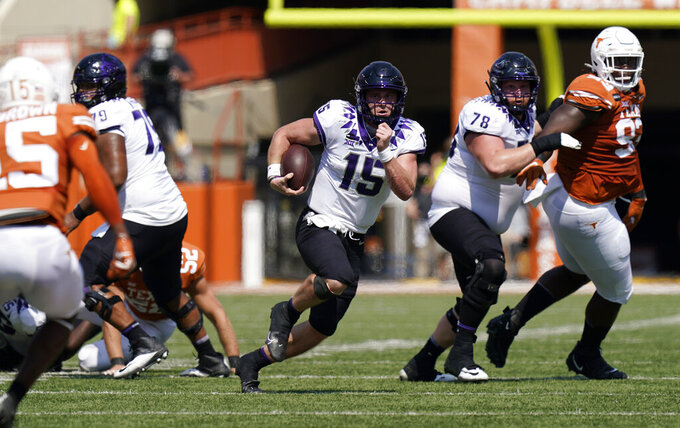 TCU quarterback Max Duggan (15) runs against Texas during the first half of an NCAA college football game, Saturday, Oct. 3, 2020, in Austin, Texas. (AP Photo/Eric Gay)