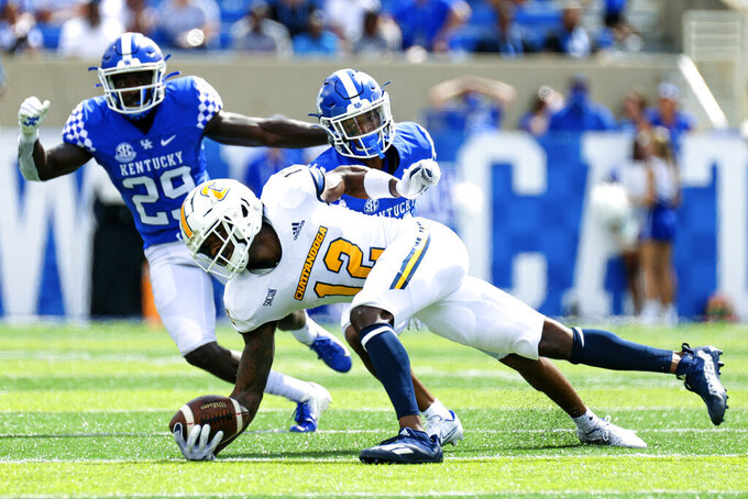 Chattanooga wide receiver Reginald Henderson (12) makes a diving catch during the first half of a NCAA college football game against Kentucky in Lexington, Ky., Saturday, Sept. 18, 2021. (AP Photo/Michael Clubb)