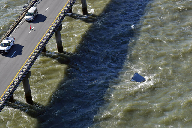 A box truck floats in the water after driving off the Chesapeake Bay Bridge-Tunnel Tuesday morning Dec. 29, 2020, near Virginia Beach, Va. (Jonathon Gruenke/The Daily Press via AP)