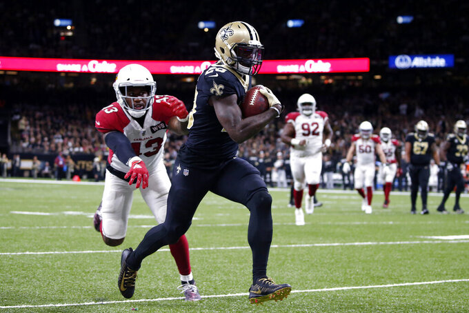 New Orleans Saints running back Latavius Murray (28) carries for a touchdown past Arizona Cardinals outside linebacker Haason Reddick (43) in the second half of an NFL football game in New Orleans, Sunday, Oct. 27, 2019. (AP Photo/Butch Dill)