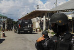 Police guard the entrance to the Anisio Jobim Prison Complex after a deadly riot erupted among inmates in Manaus in the northern state of Amazonas, Brazil, Sunday, May 26, 2019. A statement from the state prison secretary says prisoners began fighting among themselves around noon Sunday, and security reinforcements were rushed to complex. (AP Photo/Edmar Barros)