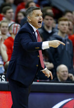 Ohio State coach Chris Holtmann directs his team during the first half of an NCAA college basketball game against Wisconsin in Columbus, Ohio, Sunday, March 10, 2019. (AP Photo/Paul Vernon)