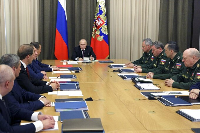 Russian President Vladimir Putin attends a meeting with a cabinet members and high range military officials in the Bocharov Ruchei residence in the Black Sea resort of Sochi, Russia, Tuesday, May 25, 2021. (Sergei Ilyin, Sputnik, Kremlin Pool Photo via AP)