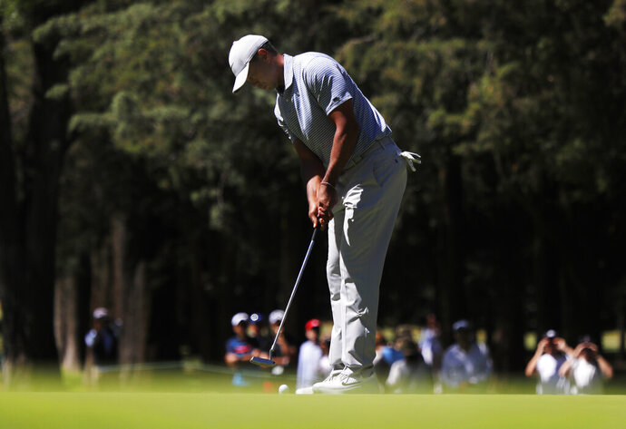 Tiger Woods putts on the 1st green during the first round of the the WGC-Mexico Championship at the Chapultepec Golf Club in Mexico City, Thursday, Feb. 21, 2019. (AP Photo/Marco Ugarte)