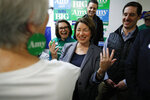 Democratic presidential candidate Sen. Amy Klobuchar, D-Minn., reacts while meeting supporters at a campaign office, Saturday, Feb. 22, 2020, in Las Vegas. (AP Photo/John Locher)