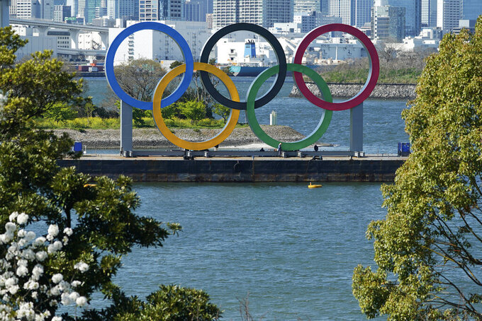FILE - In this March 24, 2020, file photo, the Olympic rings is seen at Tokyo's Odaiba district. The postponed Tokyo Olympics are to open in just under nine months, and there are still far more questions than answers. Organizers and the International Olympic Committee say they are working on a vast number of contingency plans to hold the Games in the midst of a pandemic. (AP Photo/Eugene Hoshiko, File)