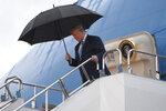 President Donald Trump walks down the steps of Air Force One at Osaka International (Itami) Airport, in Osaka, Japan, Thursday, June 27, 2019. Trump is in Osaka to attend the G20 summit. (AP Photo/Susan Walsh)