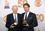 FILE - In this Feb. 10, 2008 file photo, Beatles producer George Martin, left, and his son Giles Martin appear in the press room with their awards for best compilation soundtrack and best surround sound album for