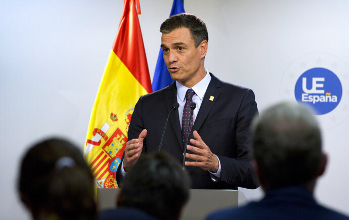 Spanish Prime Minister Pedro Sanchez speaks during a media conference at an EU summit in Brussels, Tuesday, July 2, 2019. European Union leaders on Tuesday, July 2, 2019, after a lengthy session of talks, named current Belgian Prime Minister Charles Michel for the post of President of the European Commission. (AP Photo/Virginia Mayo)
