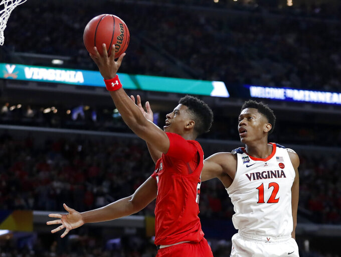 Texas Tech's Jarrett Culver (23) takes a shot against Virginia's De'Andre Hunter (12) during the second half in the championship of the Final Four NCAA college basketball tournament, Monday, April 8, 2019, in Minneapolis. (AP Photo/Jeff Roberson)