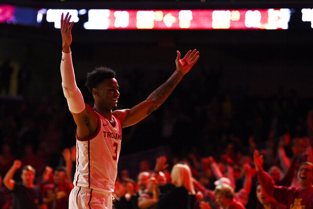 Southern California guard Elijah Weaver celebrates after USC defeated Stanford 82-78 in overtime in an NCAA college basketball game in Los Angeles, Saturday, Jan. 18, 2020. (AP Photo/Kelvin Kuo)