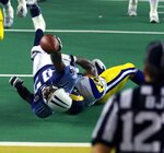 FILE - In this Jan. 30, 2000, file photo, Tennessee Titans wide receiver Kevin Dyson (87) is tackled short of the goal line by St. Louis Rams linebacker Mike Jones on the final play of Super Bowl 34 to preserve the Rams 23-16 win in Atlanta. When an ice storm blanketed Atlanta before the city's last Super Bowl in 2000, the fear was the big game would never return. Atlanta Falcons owner Arthur Blank's $1.5 billion Mercedes-Benz Stadium quickly swayed the NFL owners to give Atlanta another chance. (AP Photo/Michael Conroy, File)