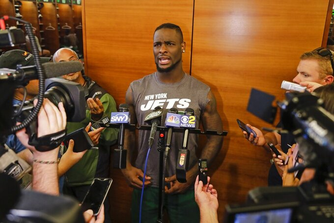 New York Jets running back Le'Veon Bell responds to questions during a news conference at the team's NFL football training facility Wednesday, Aug. 21, 2019, in Florham Park, N.J. (AP Photo/Frank Franklin II)