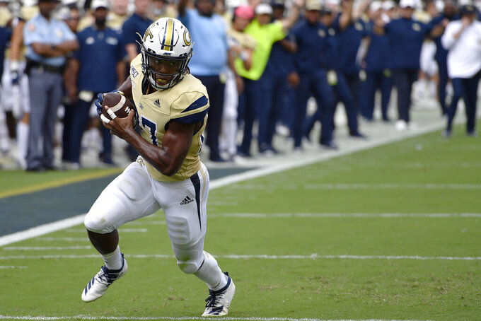 Georgia Tech running back Jordan Mason (27) runs to the end zone for a touchdown during the first half of an NCAA college football game, Saturday, Sept. 14, 2019, in Atlanta. (AP Photo/Mike Stewart)