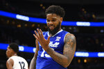 Seton Hall guard Myles Powell (13) looks at his hand after he scored a basket during the first half of an NCAA college basketball game against Georgetown, Wednesday, Feb. 5, 2020, in Washington. (AP Photo/Nick Wass)