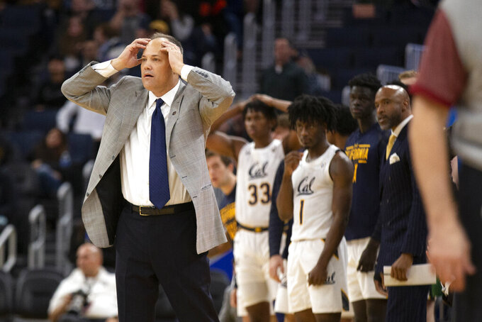 California head coach Mark Fox, left, reacts to his team's play against Boston College during the second half of an NCAA college basketball game on Saturday, Dec. 21, 2019, in San Francisco. (AP Photo/D. Ross Cameron)
