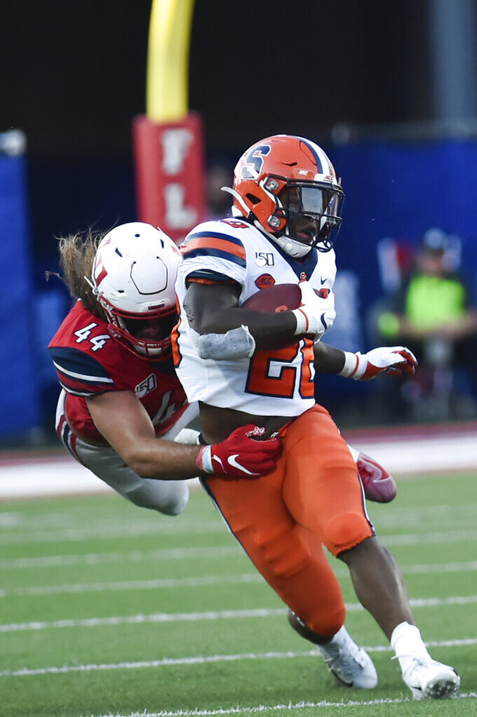 Liberty defensive lineman Austin Lewis tackles Syracuse running back Jarveon Howard during the first game of the season against on Saturday, August 31, 2019 at Williams Stadium.(Emily Elconin/The News & Advance via AP)