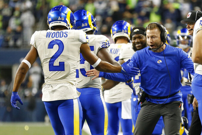 Los Angeles Rams head coach Sean McVay, right, greets Robert Woods (2) and running back Sony Michel (25), second from left, after Michel scored a touchdown against the Seattle Seahawks during the second half of an NFL football game, Thursday, Oct. 7, 2021, in Seattle. (AP Photo/Craig Mitchelldyer)