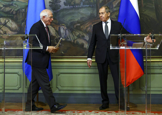 """In this photo released by the Russian Foreign Ministry Press Service, Russian Foreign Minister Sergey Lavrov, right, and High Representative of the EU for Foreign Affairs and Security Policy, Josep Borrell leave a joint news conference following their talks in Moscow, Russia, Friday, Feb. 5, 2021. The European Union's top diplomat told Russia's foreign minister Friday that the treatment of Russian opposition leader Alexei Navalny represents """"a low point"""" in the relations between Brussels and Moscow. EU foreign affairs chief Josep Borrell met with Russian Foreign Minister Sergey Lavrov several days after Navalny was ordered to serve nearly three years in prison, a ruling that elicited international outrage. (Russian Foreign Ministry Press Service via AP)"""