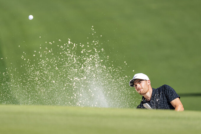 Aaron Wise hits out of a bunker on the eighth hole during the third round of the Wells Fargo Championship golf tournament at Quail Hollow, Saturday, May 8, 2021, in Charlotte, N.C. (AP Photo/Jacob Kupferman)