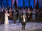 In this Dec. 4, 2018 photo released by the Metropolitan Opera, conductor Yannick Nézet-Séguin acknowledges the crowd at a curtain call following the new production premiere of Verdi's