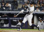 New York Yankees' Mike Tauchman hits a home run during the fifth inning of a baseball game against the Kansas City Royals, Friday, April 19, 2019, in New York. (AP Photo/Frank Franklin II)