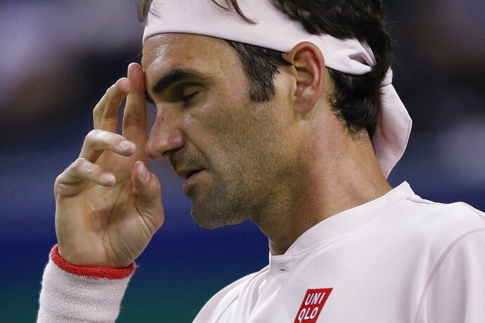 Roger Federer of Switzerland reacts after losing a point to Roberto Bautista Agut of Spain during their men's singles match of the Shanghai Masters tennis tournament at Qizhong Forest Sports City Tennis Center in Shanghai, China, Thursday, Oct. 11, 2018. (AP Photo/Andy Wong)