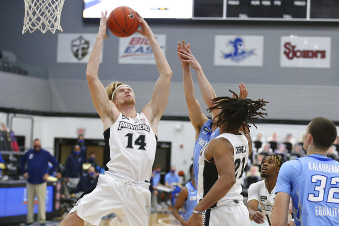 Providence's Noah Horchler (14) grabs a rebound during the first half of an NCAA college basketball game against Creighton Saturday, Jan. 2, 2021, in Providence, R.I. (AP Photo/Stew Milne)