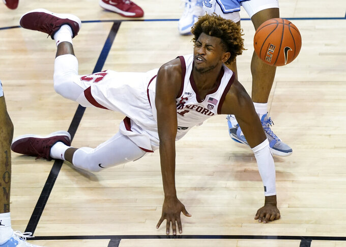 Stanford guard Daejon Davis (1) falls to the court after losing control of the ball during an NCAA college basketball game in the semifinals of the Maui Invitational, Tuesday, Dec.1, 2020, in Asheville, N.C. (AP Photo/Kathy Kmonicek)