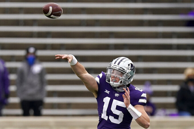 Kansas State quarterback Will Howard passes the ball during the first half of an NCAA football game against Kansas Saturday, Oct. 24, 2020, in Manhattan, Kan. (AP Photo/Charlie Riedel)