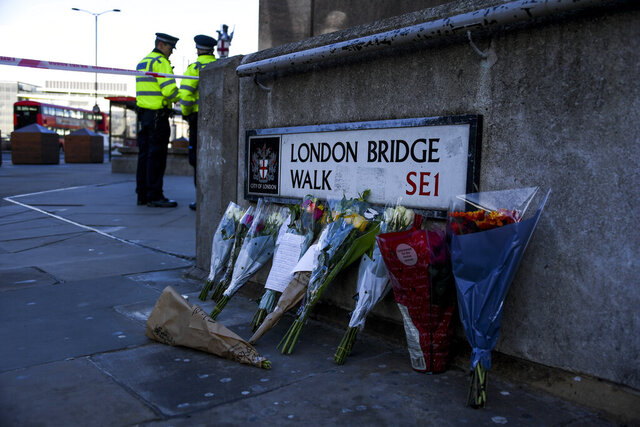 Flowers are left following Friday's terror attack on London Bridge in London, Sunday, Dec. 1, 2019.  A man wearing a fake suicide vest was subdued by bystanders as he went on a knife rampage killing two people and wounding others before being shot dead by police on Friday. (AP Photo/Alberto Pezzali)