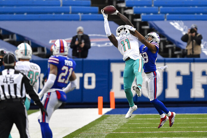 Miami Dolphins wide receiver DeVante Parker (11) makes a catch against Buffalo Bills cornerback Josh Norman (29) in the second half of an NFL football game, Sunday, Jan. 3, 2021, in Orchard Park, N.Y. (AP Photo/Adrian Kraus)