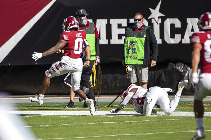 Temple wide receiver Randle Jones (0) returns the opening kickoff for a touchdown in the first half of an NCAA football game against SMU, Saturday, Nov. 7, 2020, in Philadelphia. (AP Photo/Laurence Kesterson)