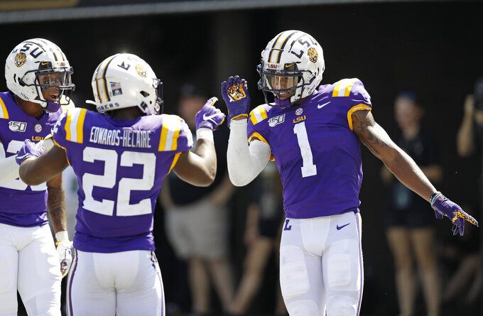 No. 5 LSU hosts Utah State in matchup of up-tempo attacks