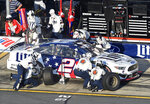 Crew members perform a pit stop on Brad Keselowski's car during a NASCAR Cup Series auto race at Charlotte Motor Speedway in Concord, N.C., Sunday, May 26, 2019. (AP Photo/Mike McCarn)