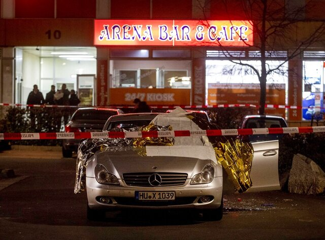 A car with dead bodies stands in front of a bar in Hanau, Germany, Thursday, Feb. 20, 2020. German police say several people were shot to death in the city of Hanau on Wednesday evening. (AP Photo/Michael Probst)