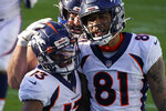 Denver Broncos wide receiver KJ Hamler, left, celebrates after scoring with wide receiver Tim Patrick during the second half of an NFL football game against the Carolina Panthers Sunday, Dec. 13, 2020, in Charlotte, N.C. (AP Photo/Gerry Broome)