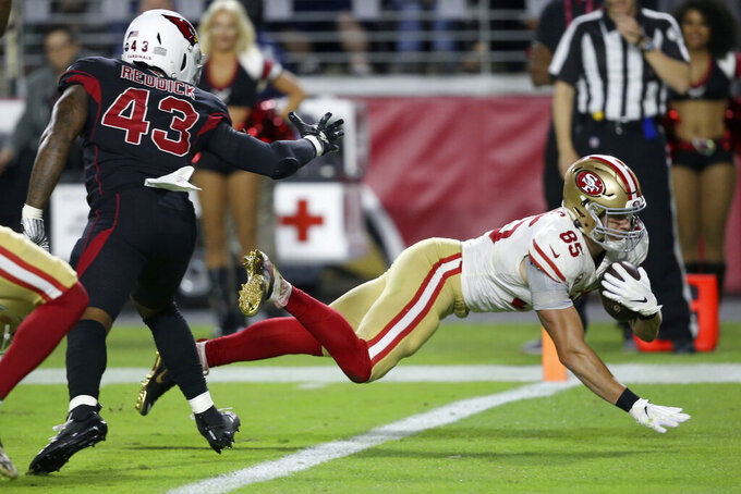 San Francisco 49ers George Kittle (85) scores a touchdown as Arizona Cardinals outside linebacker Haason Reddick (43) defends during the first half of an NFL football game, Thursday, Oct. 31, 2019, in Glendale, Ariz.(AP Photo/Ross D. Franklin)