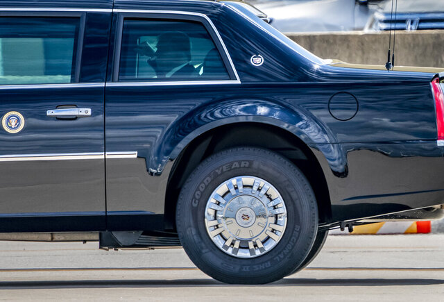 In a photo from Friday, Aug. 14, 2020, President Donald Trump rides in the heavily armored limousine known as