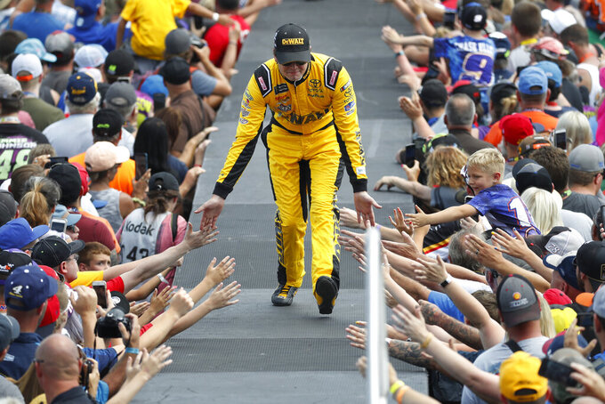 Erik Jones greets fans before a NASCAR Cup Series auto race at Michigan International Speedway in Brooklyn, Mich., Sunday, Aug. 11, 2019. (AP Photo/Paul Sancya)