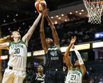 Seattle Storm's Breanna Stewart (30) pulls down the ball over Chicago Sky's Astou Ndour-Fall (45) in the first quarter of a WNBA basketball game Friday, Aug. 27, 2021, in Everett, Wash. (Dean Rutz/The Seattle Times via AP)