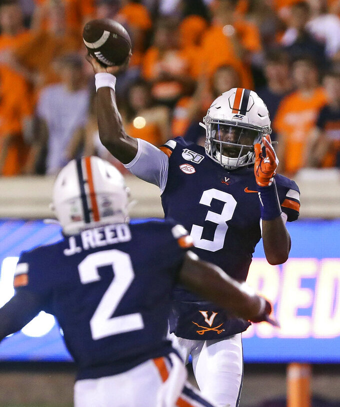 Virginia quarterback Bryce Perkins (3) throws a pass to Virginia wide receiver Joe Reed (2) during the second quarter of an NCAA college football game against Old Dominion in Charlottesville, Va., Saturday, Sept. 21, 2019. (AP Photo/Andrew Shurtleff)
